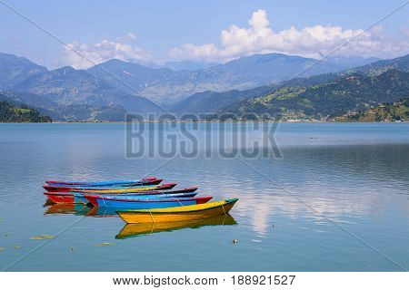 Lake Phewa wooden boat in Pokhara Nepal with the Himalayan mountains in the background