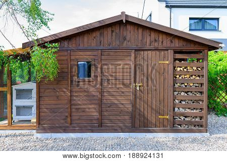 Garden shed exterior in Spring with woodshed