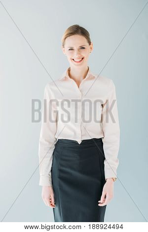 Portrait Of Young Attractive Caucasian Businesswoman In Formalwear Smiling, Isolated On Grey