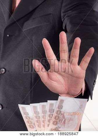 Businessman decline a bribe on isolated / white background. Stop corruption and fraud concepts