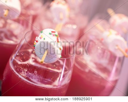Closeup white marshmallow on stick on lychee soda fresh drink glass (Soft Color Tone)