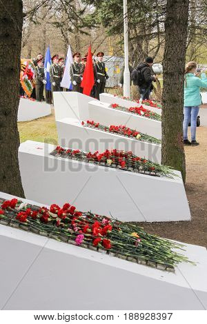 Kirishi, Russia - 9 May, Memorable plates to the fallen heroes, 9 May, 2017. Laying wreaths and flowers in memory of the fallen at the Eternal Flame.