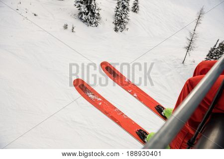 Skier travelling in ski lift during winter