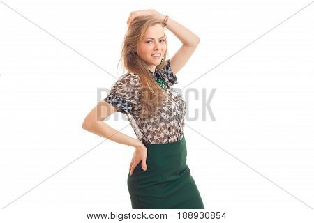 beautiful young blonde frenzy keeps hand hair looks forward and smiling isolated on white background