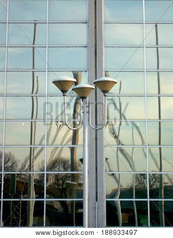 refraction and reflection of the bridge pylon in a glass facade