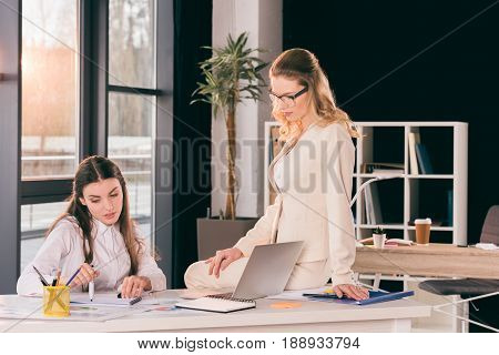 Young Caucasian Businesswomen In Formalwear Talking While Working At Modern Office