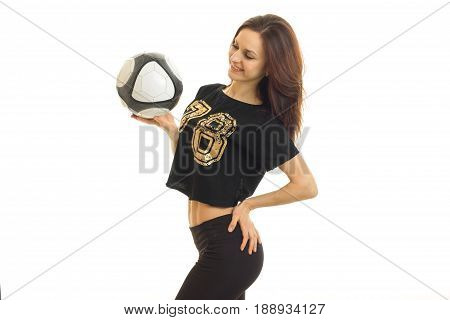 slender athletic brunette holding a soccer ball and smiling isolated on white background