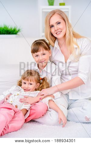 Happy family spending time together. Loving daughters with their dear mother.