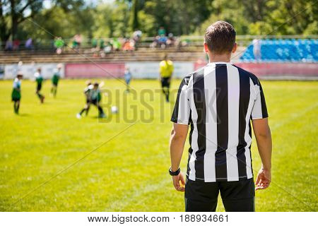 Coach of Youth Soccer Team. Coaching Football Soccer Kids. Soccer Practice Match on the Pitch. Coaching Youth Soccer