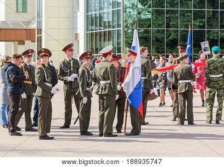 Kirishi, Russia - 9 May, A flag group with a flag, 9 May, 2017. Preparation and conduct of the action Immortal regiment in small cities of Russia.