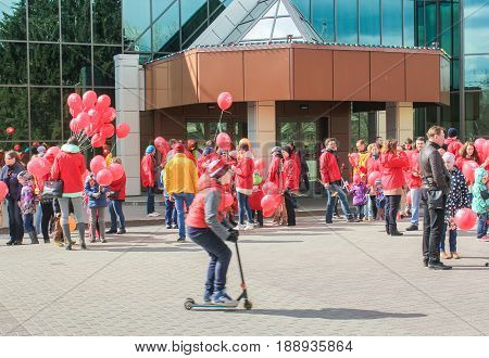 Kirishi, Russia - 9 May, A crowd of people with red balls, 9 May, 2017. Preparation and conduct of the action Immortal regiment in small cities of Russia.
