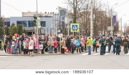 Kirishi, Russia - 9 May, A crowd of people on the sidewalk, 9 May, 2017. Preparation and conduct of the action Immortal regiment in small cities of Russia.