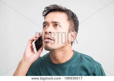 Mustache Beard Asian Man Feeling Upset While Talking On Phone