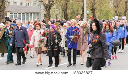 Kirishi, Russia - 9 May, Different people in the action immortal regiment, 9 May, 2017. Preparation and conduct of the action Immortal regiment in small cities of Russia.