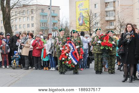 Kirishi, Russia - 9 May, Groups with wreaths for entrusting, 9 May, 2017. Holding a festive rally dedicated to the Victory Day.