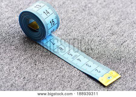 Tape For Measuring On Light Grey Background