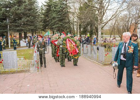 Kirishi, Russia - 9 May, Groups with wreaths for entrusting, 9 May, 2017. Laying wreaths and flowers in memory of the fallen at the Eternal Flame.