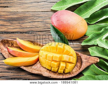 Mango fruits  on the old wooden table.