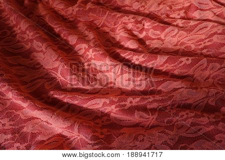 Folded Pinkish Orange Guipure Cloth With Shadows