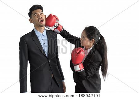 Portrait Of Aggressive Business Lady In Boxing Gloves Kicking His Rival