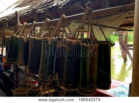 Bamboo cylinder for drinking water,Bamboo Cylinder selling on the street,Green bamboo cylinder.