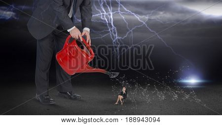 Digital composite of Digital composite image of businessman watering employee during thunder storm