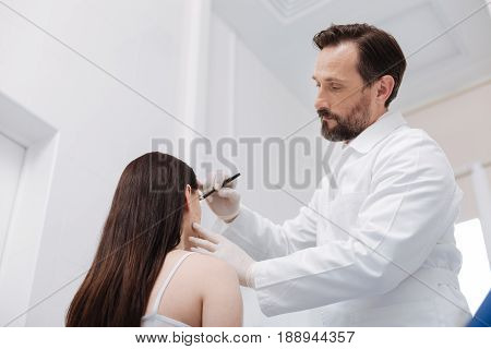 New masterpiece. Excellent experienced skillful doctor preparing his patient for cosmetic procedure and applying guidelines ensuring preciseness