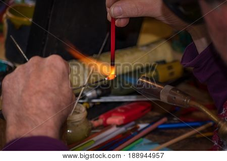 Glassmaker Shapes Glass Into Folk Figure - Folk Art