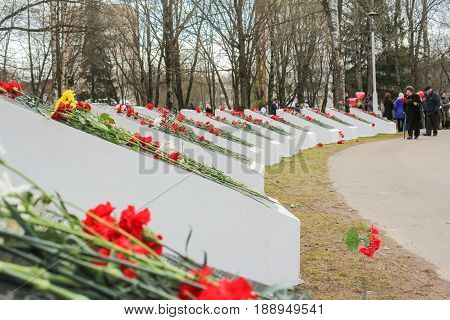 Kirishi, Russia - 9 May, Semicircle of memorable plates with flowers, 9 May, 2017. Laying wreaths and flowers in memory of the fallen at the Eternal Flame.