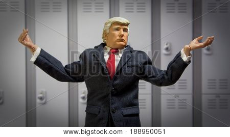 Caricature of United States President Donald Trump in front of gym lockers - locker room talk concept - action figure toy