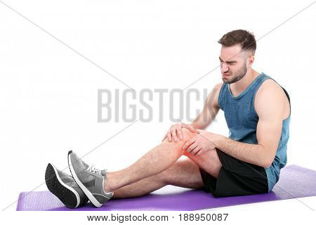 Concept of orthopedist. Man suffering from pain in knee on white background