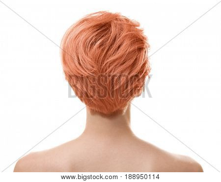 Trendy hairstyle ideas. Young woman with dyed apricot hair on white background