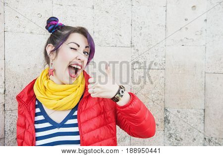 Young Beautiful Fashion Hipster Woman With Colorful Hair Winking