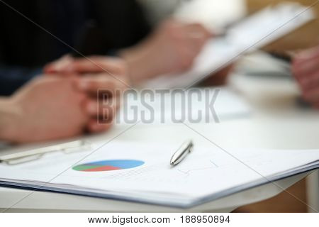 Silver Pen Lying On Financial Document Clipboard Pad