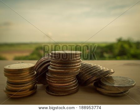 Rows of coins and account for financeSaving money Financial business concept. (Vintage colors picture)