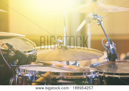 Professional drum set on the stage in the indoor concert hall event with falre added