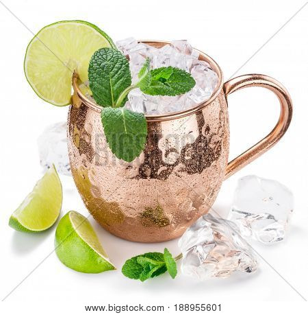 Moscow Mule. Frosty copper mug with lime and ice cubes. Isolated on the white background.