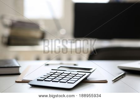 Black Calculator And Financial Statistics On Clipboard Pad