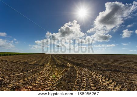 Plowed Agricultural Fields In Normandy, France. Countryside Landscape. Environment Friendly Farming