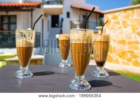 Glasses of freppe - greek cold iced coffee on table