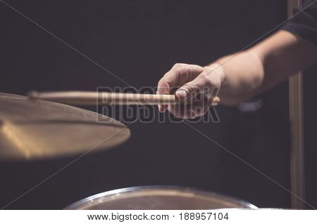 Close up of cymbal and man hand holding drumstick