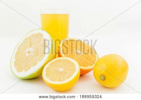 Fresh tasty juice of lemon, orange, mandarin, and sweetie on white background. Fruit concept
