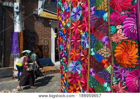 Chichicastenango Guatemala - April 24 2014: Detail of a colorful fabric which is weared by local people in a street market in the town of Chichicastenango in Guatemala.