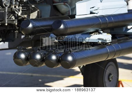 Rocket launcher under wing of military helicopter, antitank weapon, air force of modern army, aviation and aerospace industry, selective focus