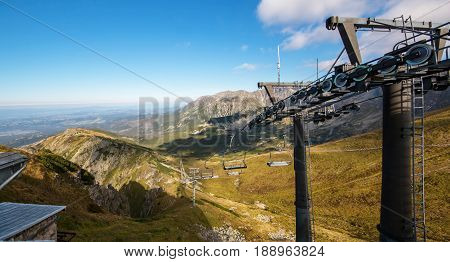 Tatry. Poland and Slovakia boundary autumn landskapes with chairlift. Big panorama photo.
