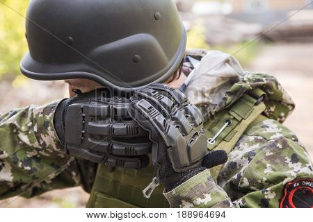 Elements Military Uniform. The Soldier Ties Up His Helmet