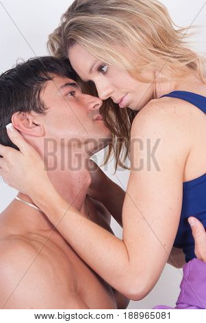 The steamy hot couple is about to kiss one another.