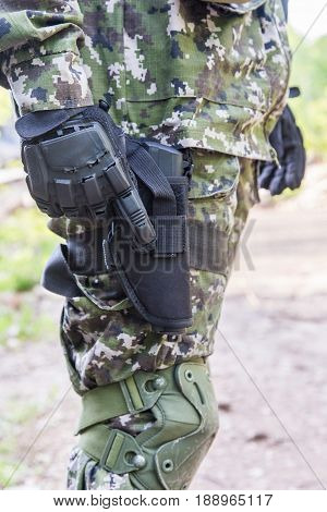 Elements Military Uniform. The Gun Is Hanging On The Thigh