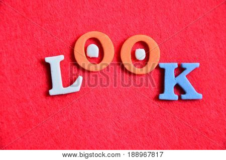word look on a  abstract red background