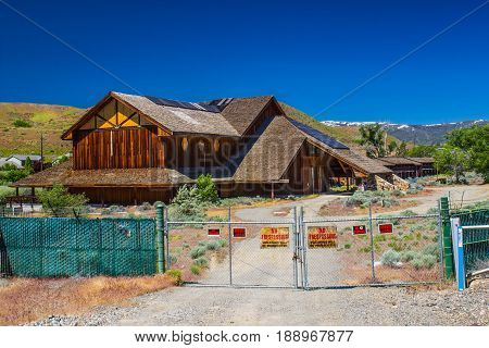 Old Abandoned Lodge & Motel With Fence